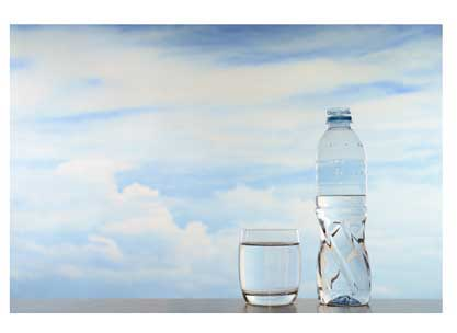 A bottle of water, a water glass, and a gorgeous blue sky.