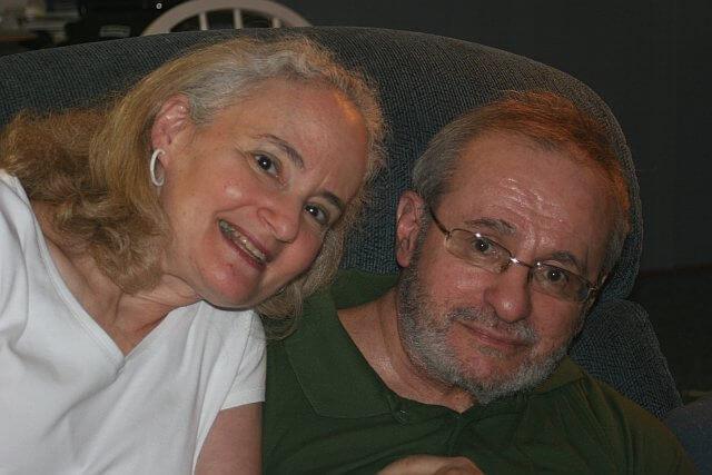 Smiling portrait of a married couple affected by FXTAS