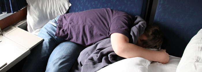 glenn-sleeps-on-Amtrak-banner