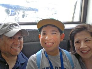 Kenny, who has Fragile X syndrome, with his mom Janet and dad Anthony