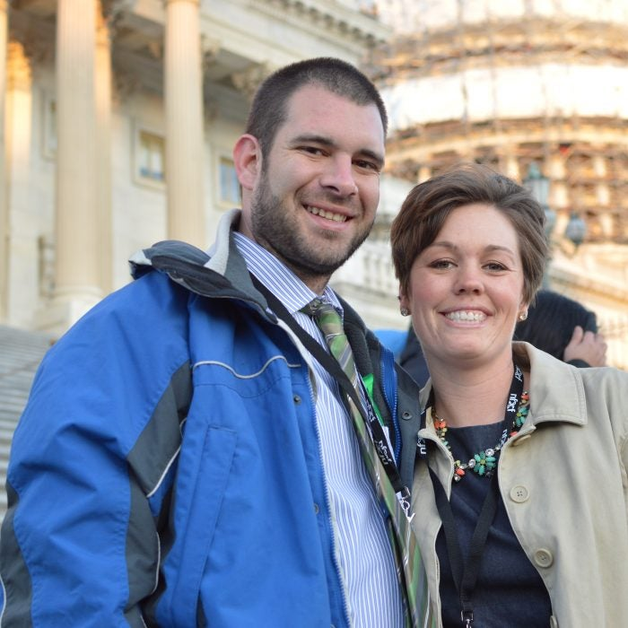 a couple on the steps of the U.S. Capitol