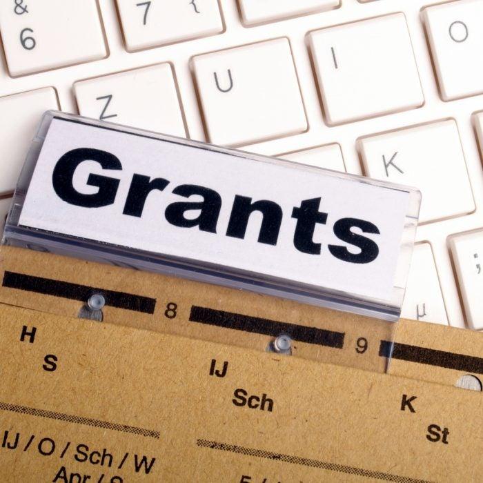 Grants written on a paper folder