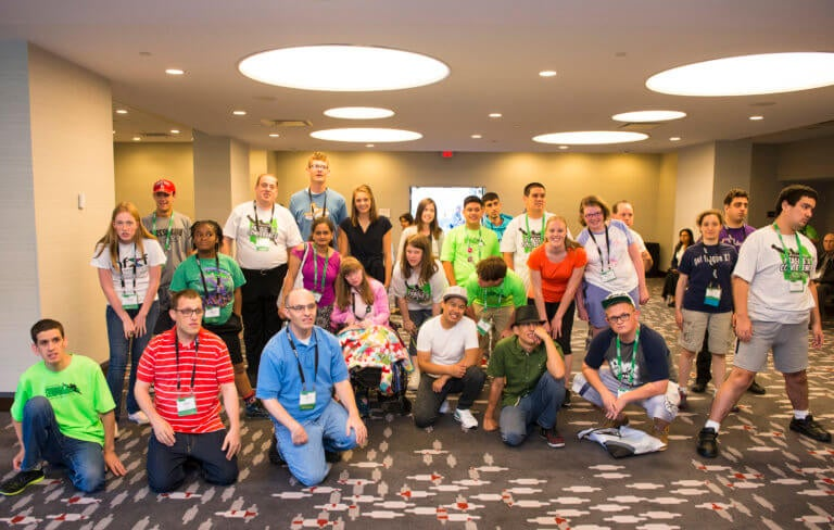 Fragile X Conference attendees pose for a group photo in Cincinnati