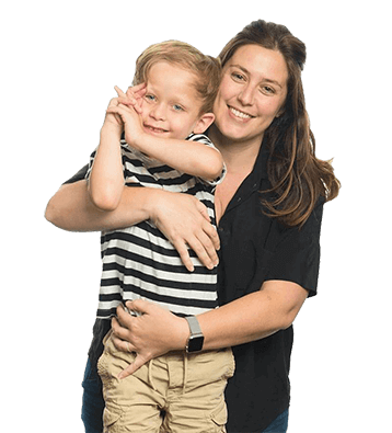 A mother holding her son who has Fragile X syndrome