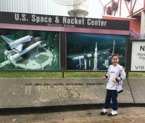 Riley in front of the U.S. Space & Rocket Center, Huntsville, Alabama.