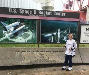 Riley in front of the U.S. Space & Rocket Center, Huntsville, Alabama.