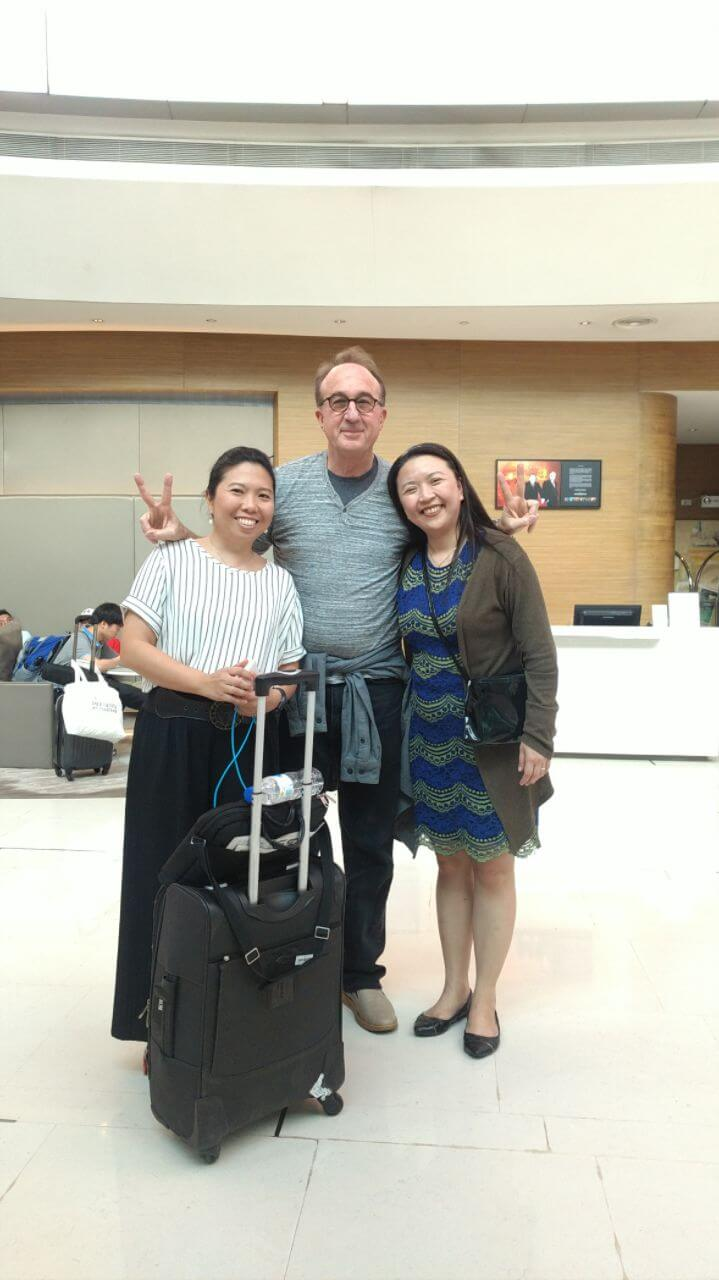 Robby Miller with two others in the Philippines for Fragile X