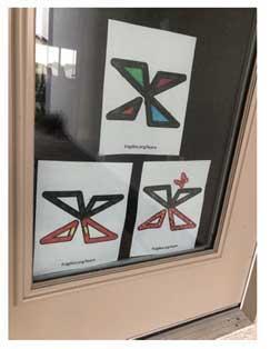 Fragile X logo X in a door window.