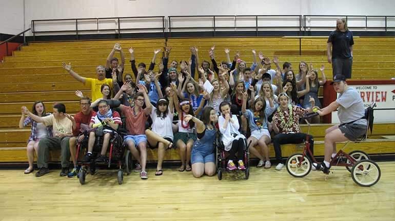 APE group photo in gymnasium