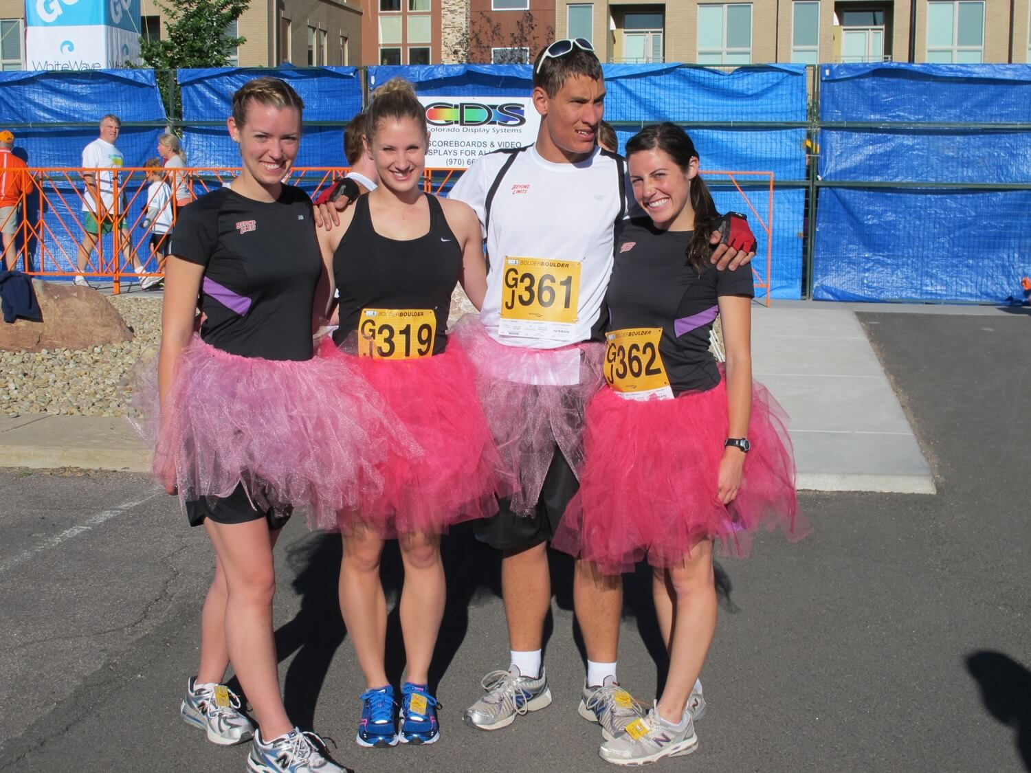 ian and his friends in pink tutus for a race