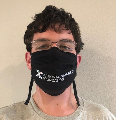 man with fragile x face mask on