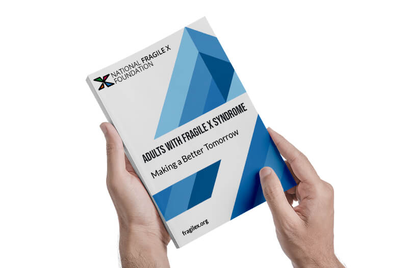 book being held with the title adults with fragile x syndrome making a better tomorrow