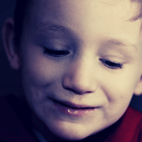 Young boy diagnosed with autism of unknown causes