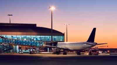 airplane at gate - exterior at sunset