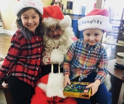 Andrew Pritchard as Santa, with with his niece and nephew.
