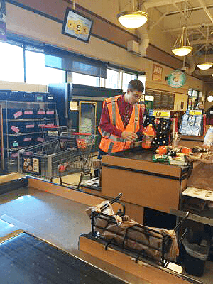 Bagger Ian working at the King Sooper checkout stand