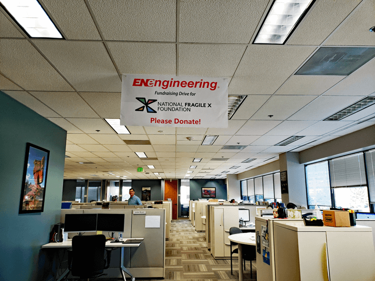 NFXF Fundraiser sign hanging from ceiling in EN Engineering office