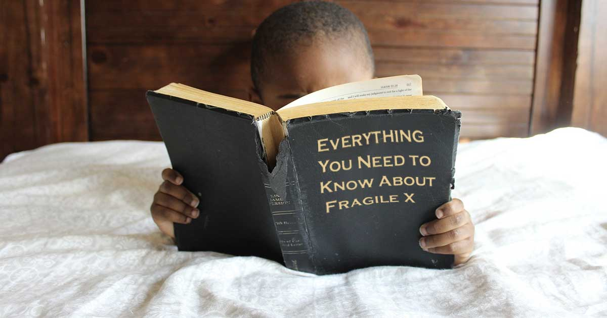 Child in bed reading Everything You Need to Know About Fragile X