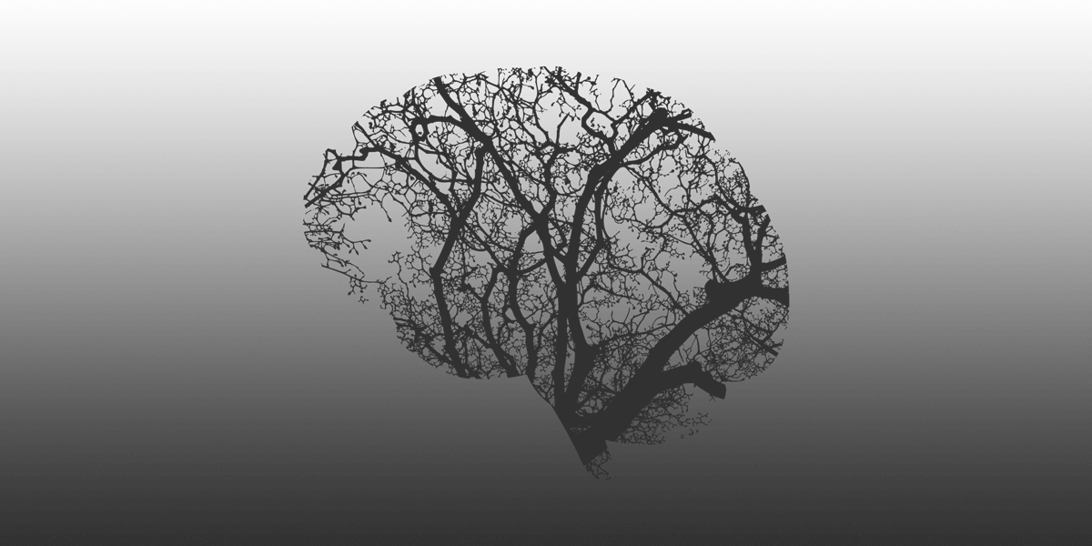 Abstract brain shape mask with trees