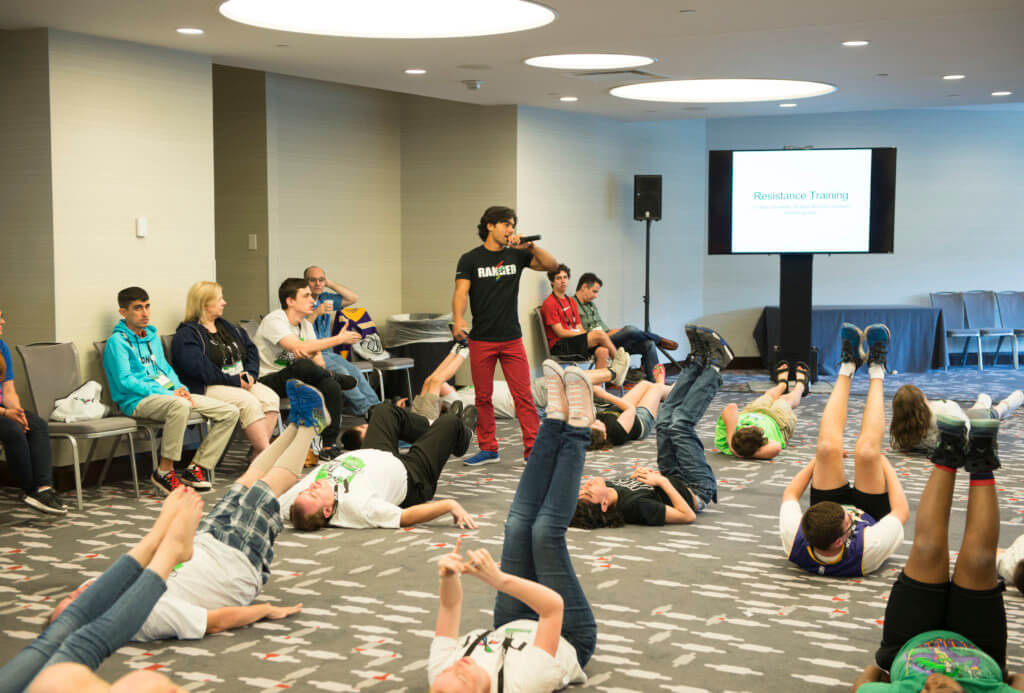 Brennan Mejia teaches an exercise session at the NFXF Conference