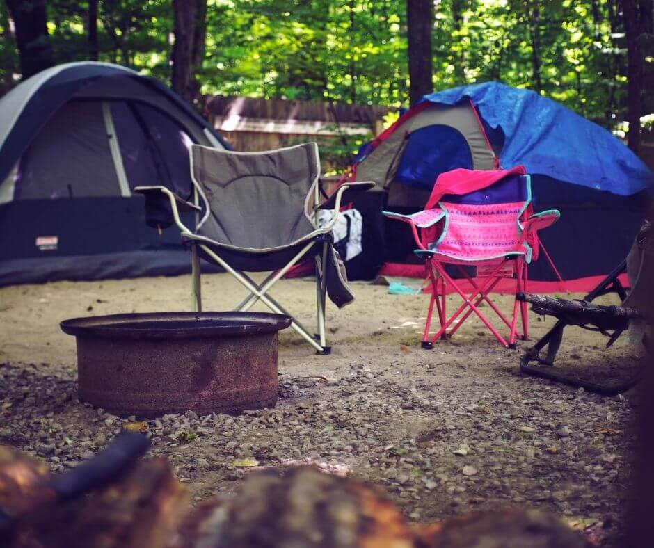 two small chairs, tents, and fire ring