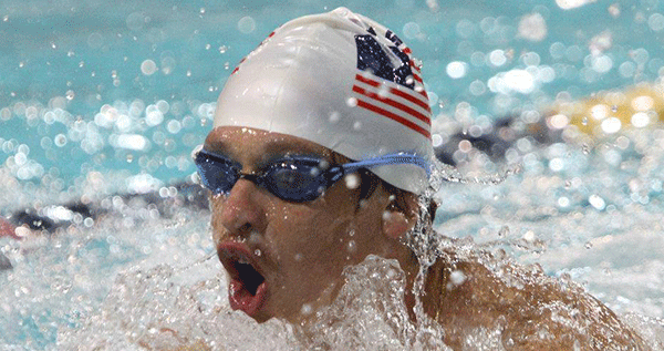 Clay Doub competing in Special Olympics breast stroke