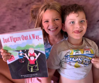 """Coralyn with her brother Rikson, and holding her book """"Just Figure Out a Way"""""""