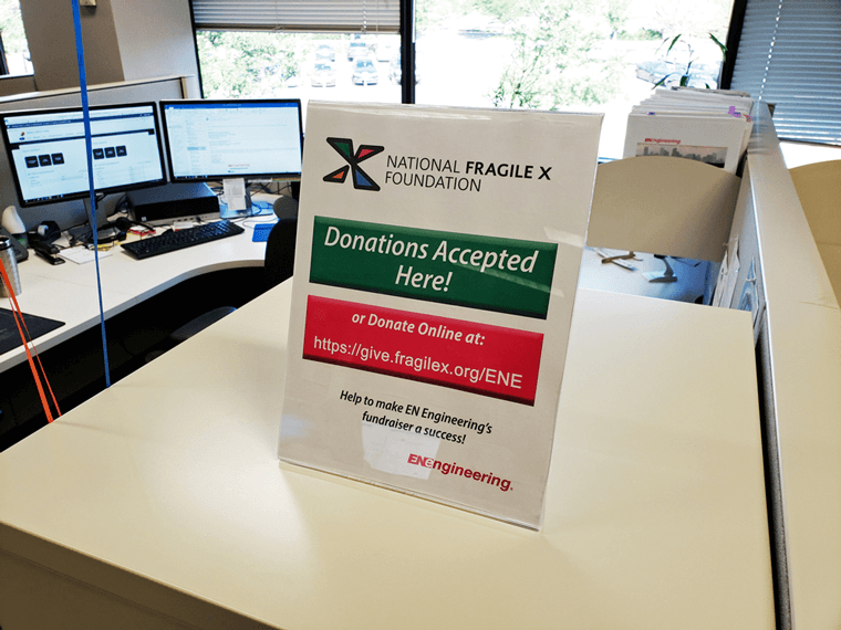 Sign announcing that donations are accepted here and fragilex.org website URL for online donations