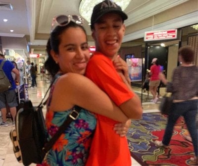 Dalia and Jonathan hugging in a shopping mall