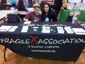 Kenny and Victoria manning a Fragile X Association of Southern California (NFXF Local Chapter) booth to advance awareness of Fragile X.