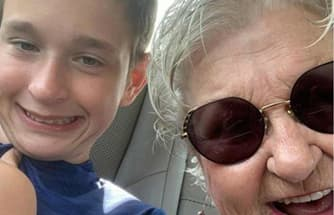 A boy and has grandmother in a car