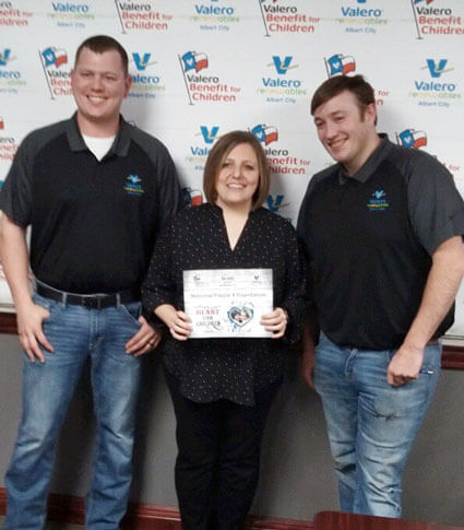 Heartland Chapter Vice President Brenda Slama accepts a $6,200 grant during the 2019 Valero Texas Open Benefit for Children.