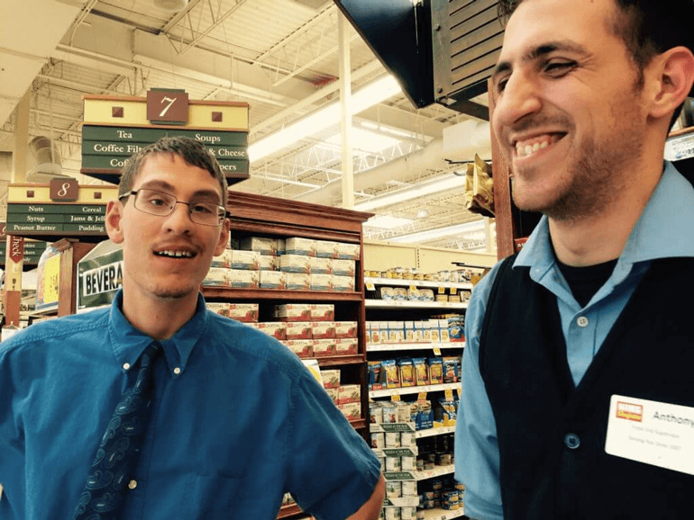 Bagger Ian and manager Anthony inside King Sooper grocery store