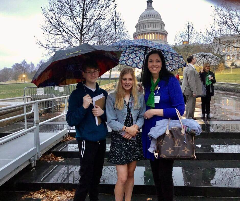 jaden randels and kacie coleman and kelly in front of U.S. Capitol in the rain