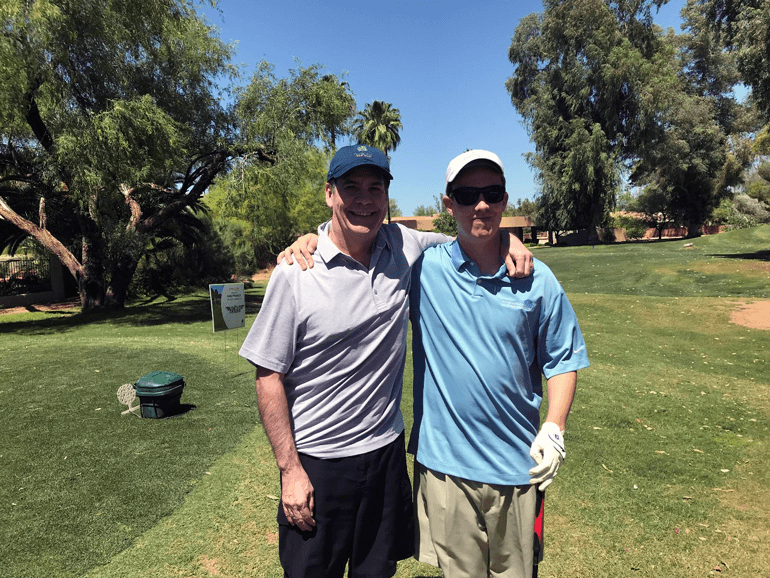 Two men on a golf course.