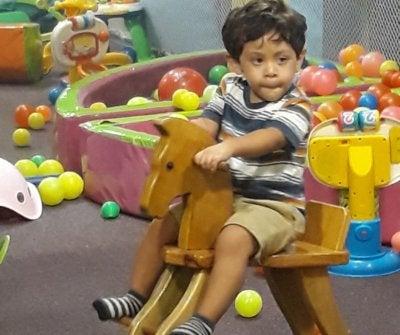 Jose Ricardo riding his toy horse