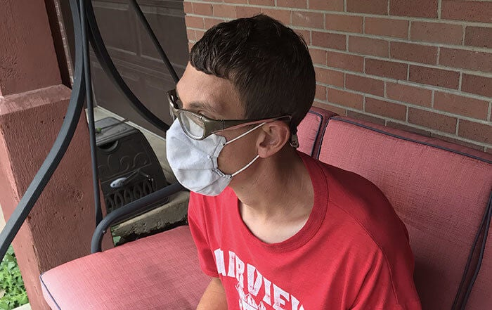 Ian out on his front porch wearing his favorite face mask