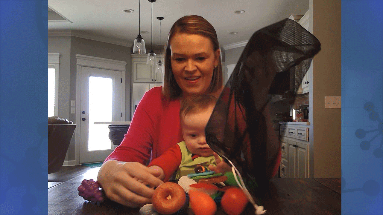 A mother at home interacting with her infant with Fragile X syndrome