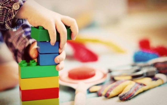 Child stacking Legos