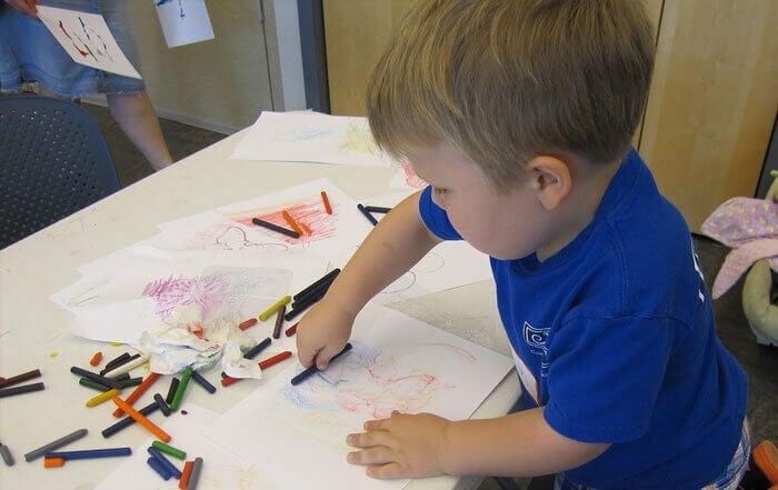 Boy using crayons