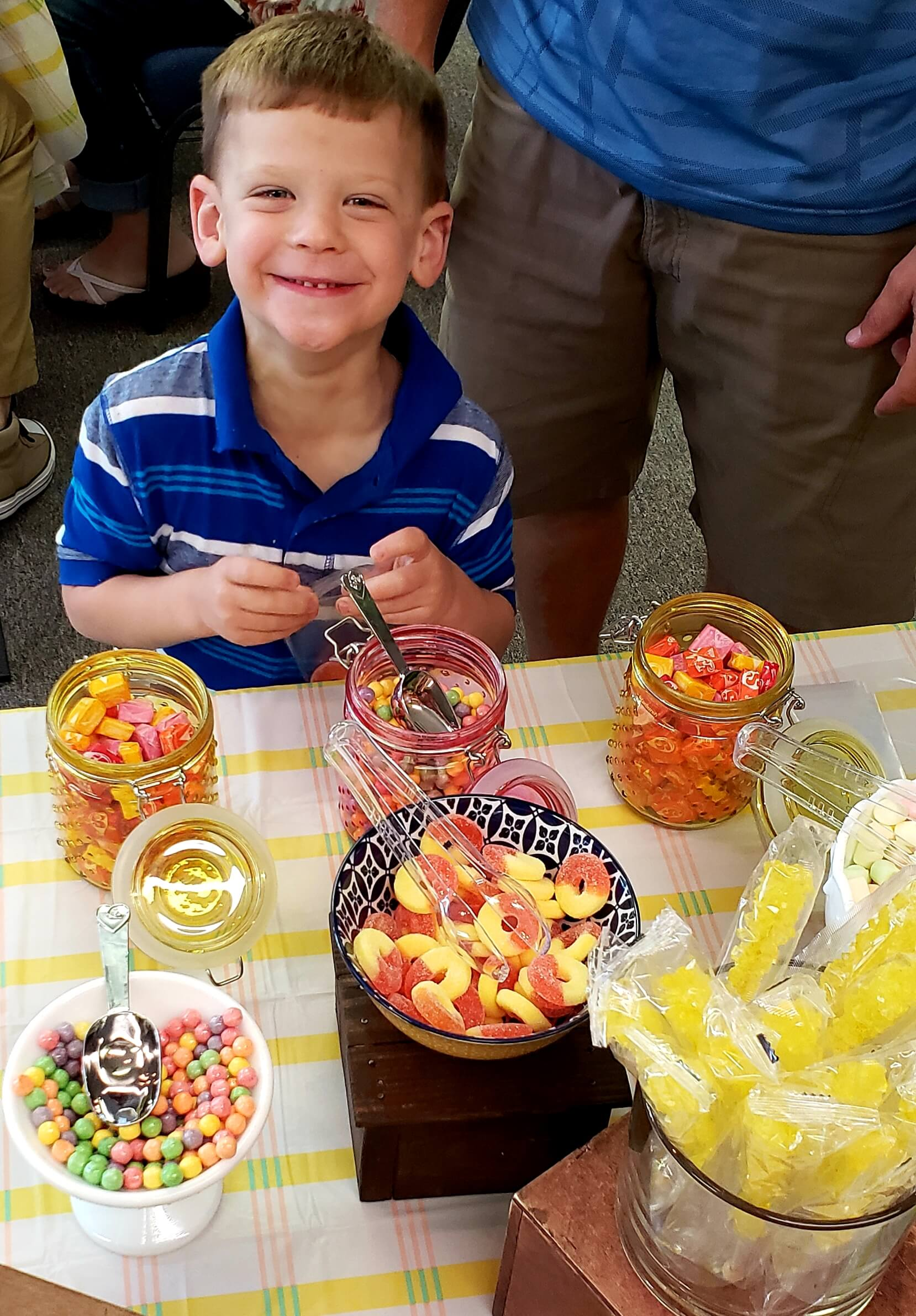 spencer - young boy with jars of candy
