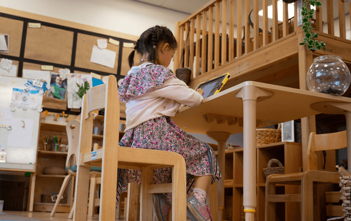 Female child working at a table in a library