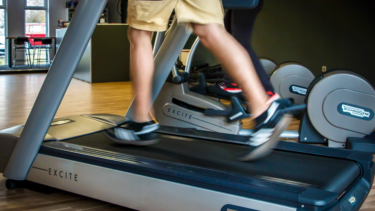 Man shown from thighs down jogging on a treadmill. Image by profivideos at Pixabay.