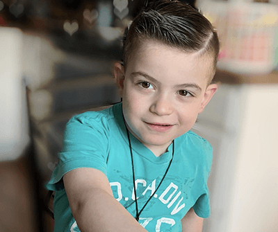 Preston Levenzon, a young boy wearing a turquoise t-shirt and a mighty spiffy hairdo