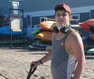 Tyler Krantz at work at a marine shop